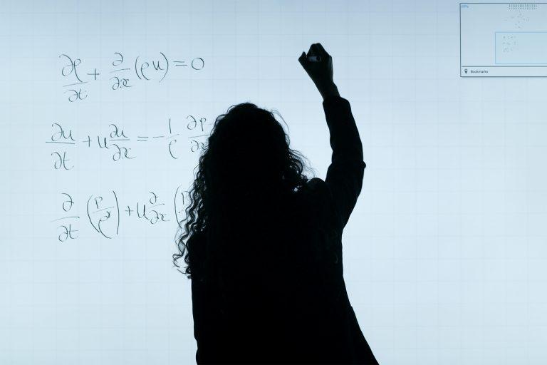 A girl writing in the board